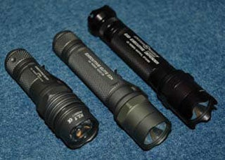 Concealed carry accessories SureFire E1E (with LED replacement head), E2E, and E2D