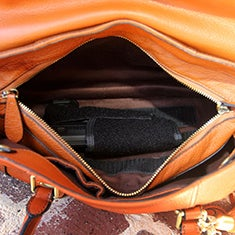 This brown leather satchel from Concealed Carry combines function and fashion.