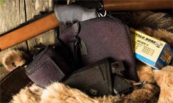 """Concealment concerns change when you head out to the woods. Not only is the clothing involved different than at the office, many folks opt for """"more gun."""""""