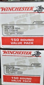 Two stacked white boxes of Winchester .223 sporting ammunition.