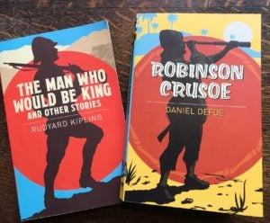 Two banned novels with colorfully illustrated book covers: The Man Who Would be King by Rudyard Kipling and Robinson Crusoe by Daniel Defoe