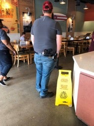 A man reportedly carrying two pistols in an unsafe manner while in line for food at a Jersey Mike's restaurant.